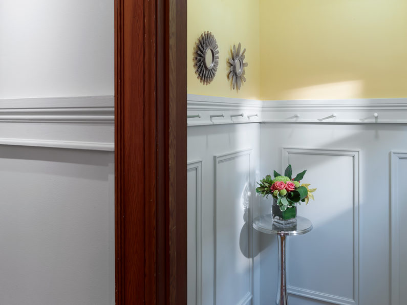 Entryway with White Chair Rail from Metrie