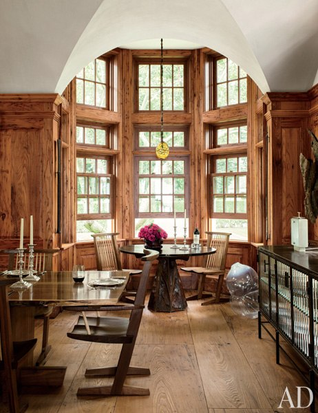 Chestnut-paneled dining room - Architectural Digest