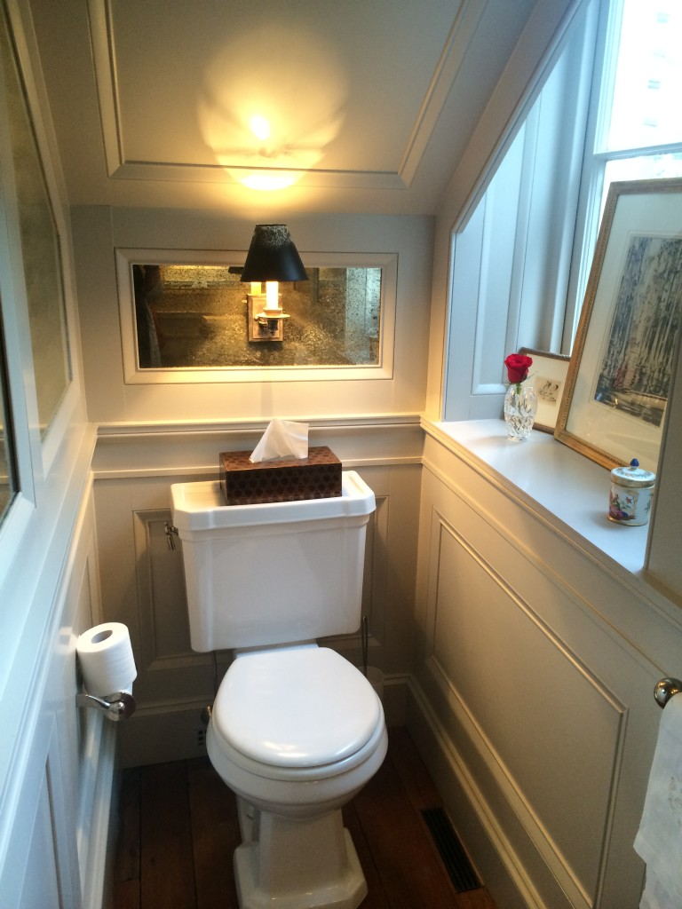 This tiny powder room, which is tuck away under the stairs, makes a big impact with the trimwork.