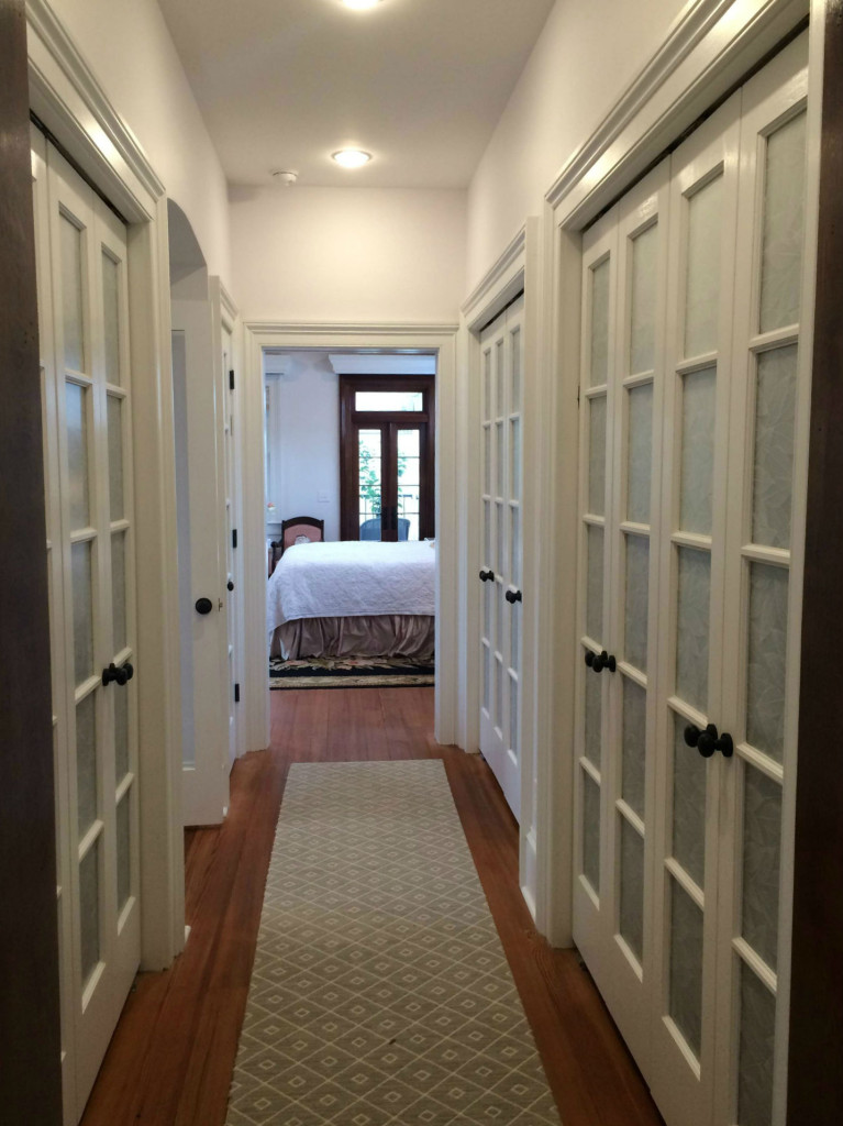 Here is a fabulous master closet, which has beautiful textured glass interior doors!