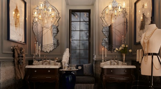 This gorgeous bathroom, designed by Regina Sturrock, starts off dark and moody and transitions to a lighter, brilliant hue, which naturally draws the eye upward.