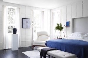 The wall treatment is the true focal point in this beautiful modern bedroom.