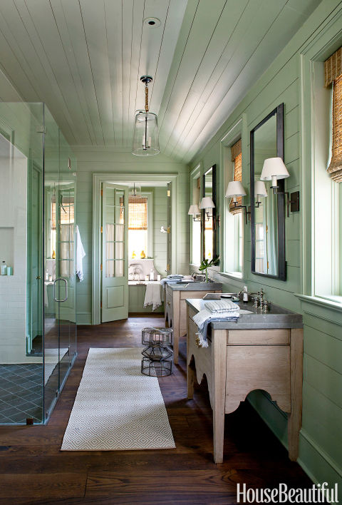 A calming green bathroom with lovely trimwork. Source: House Beautiful