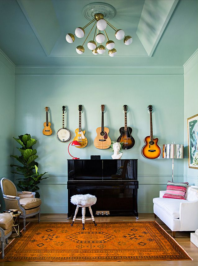 Jenny Komenda's music room boasts elegant pale green chair rail and crown moulding. Source: Domino Magazine. Photography Brittany Ambridge