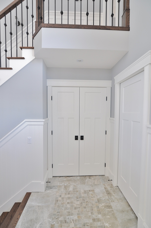 Masonite's Winslow Doors surrounded by Metrie French Curves architraves in Tyler and Amy's Saskatchewan home. (Builder: Pawluk Homes / Finisher: Mike Butts)