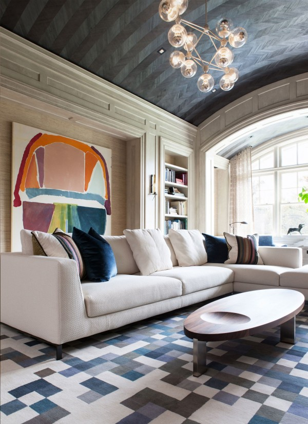 This Maryland home, designed by Tricia Huntley, mixes traditional architectural interest with modern decor. Image source: Architectural Digest.