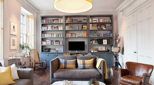 Lavish interior finishings line this modern Edinburgh living room. Image Source: Architectural Digest.