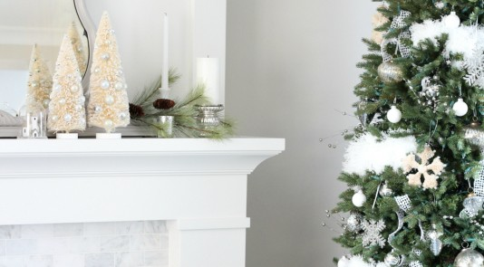 Festive decor surrounds Shauna Oberg's gorgeous fireplace made of Metrie interior finishings. Photo Credit: Shauna Oberg of Santori Design for Living