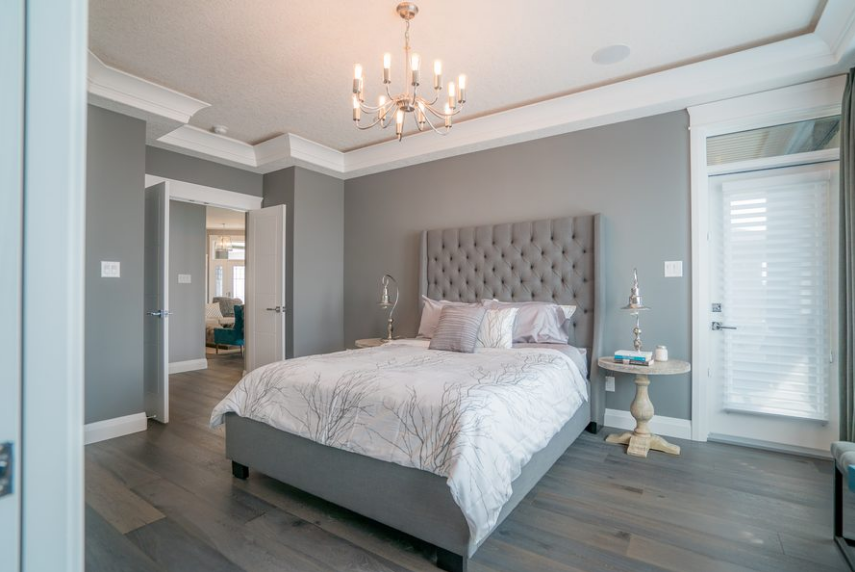 We love the use of doors and architraves in the bedroom by Harmony Builders.