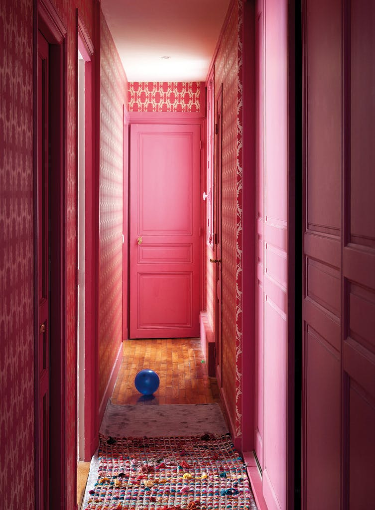 A Pink Paradise: Cheeky pink doors surrounded by gorgeous, vintage wallpaper to create a Art Deco styled hallway. Image Source: Apartment Therapy.