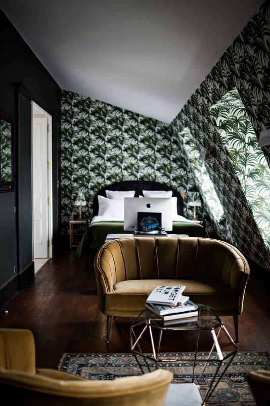Geometrically intriguing room from Hotel Providence Paris with minimalistic trim elements. Image Source: Apartment Therapy