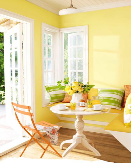 Stunning sunlit breakfast nook further enhances the soft yellow walls but is grounded with stark white casing and beige-toned panelled ceiling. Image Source: Domino.