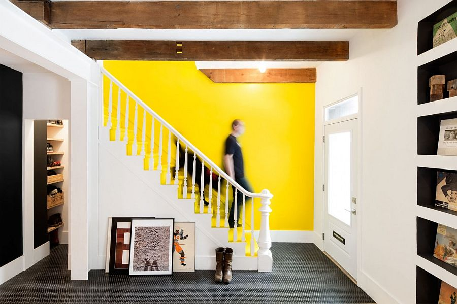 Decorist showcases a vibrant yellow accent wall in a 1880s row house. Image Source: The Decorist.