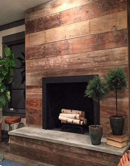 Wood-stained shiplap frames this beautifully contemporary fireplace to create a warm and rustic ambiance. Image Source: HGTV Canada.
