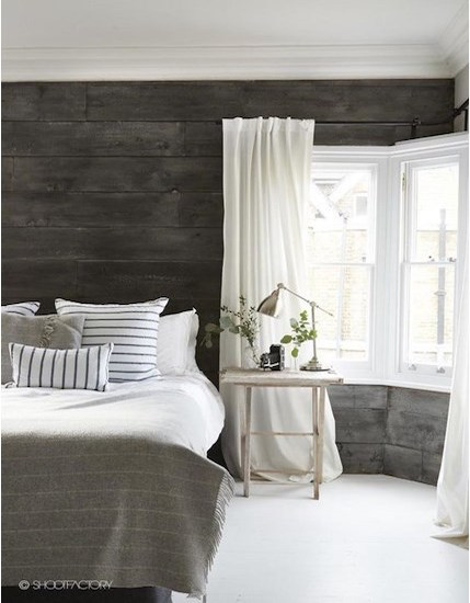 Beautiful charcoal grey washed shiplap that starkly contrasts with the beautiful clean lines of crown moulding and casing. Image Source: HGTV Canada.