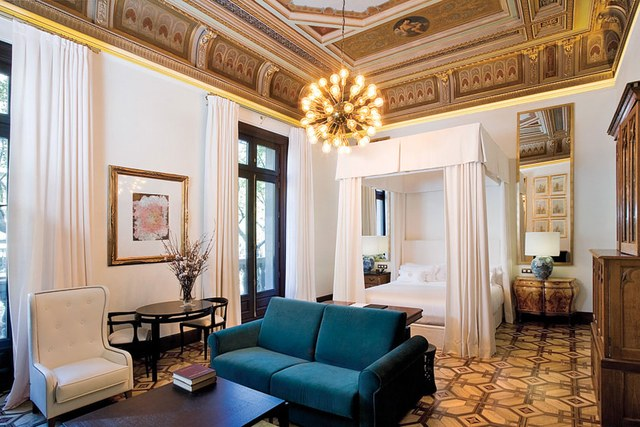 Regal trimwork in a grand, yet, welcoming room from The Cotton House Hotel in the heart of Barcelona. Image Source: Architectural Digest.