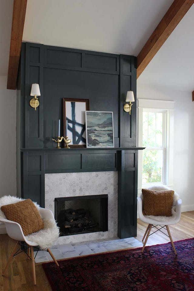Ceiling-high, beautiful black brooding fireplace treatment made with trim elements. Image Source: Apartment Therapy.