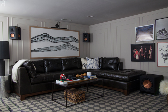 The Makerista transforms her basement into a broodingly beautiful entertainment space for her husband using Metrie's Very Square Scene I baseboard and casing. Image Source: The Makerista