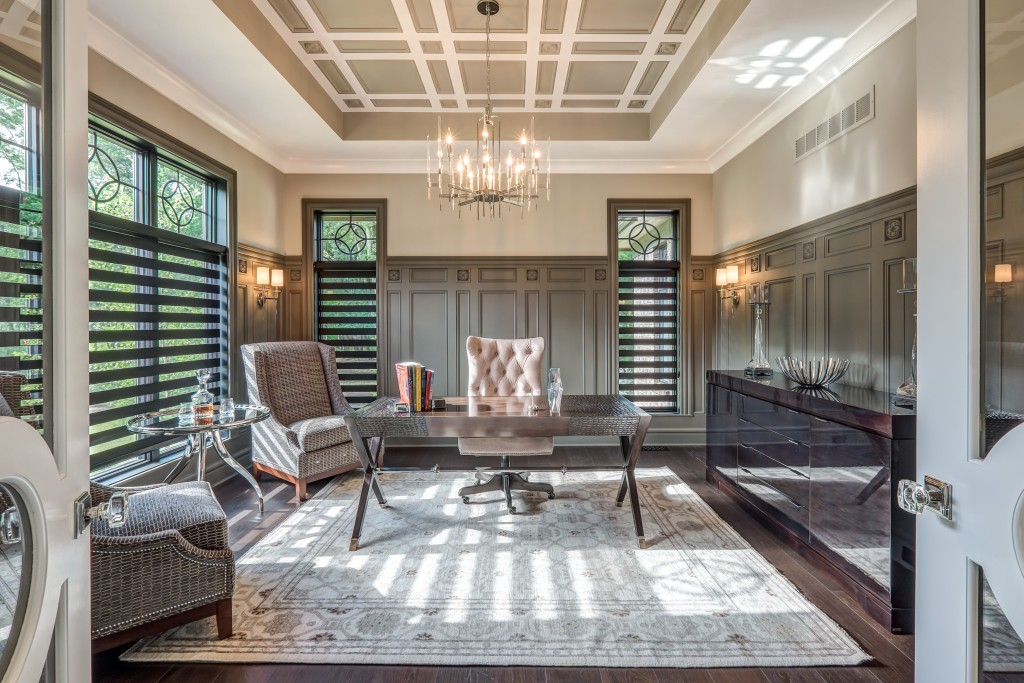 This elegant home office by G. A. White Homes wouldn't be complete without the clean lines from the ceiling details. The designer showcased Metrie's Fashion Forward and French Curves Collections.