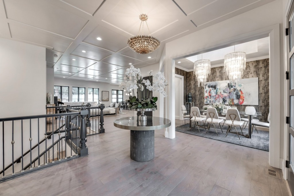 Ivory Homes creates a coffered ceiling that extend throughout the entire living area and ties the open concept space together.
