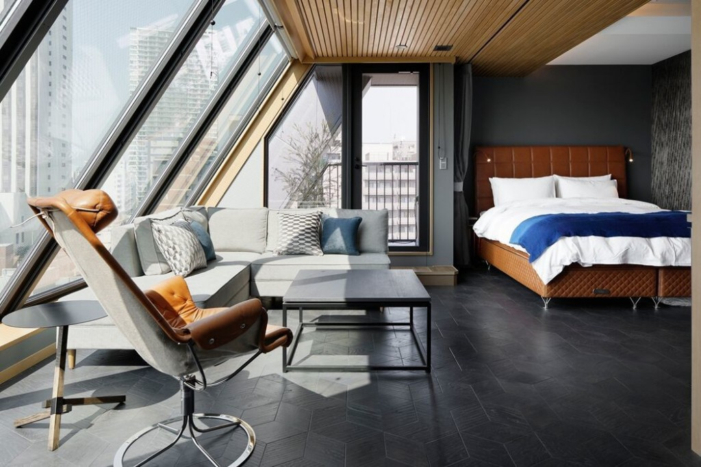 A striking contemporary room with nude trim elements from the Wired Hotel. Image Source: Dwell.