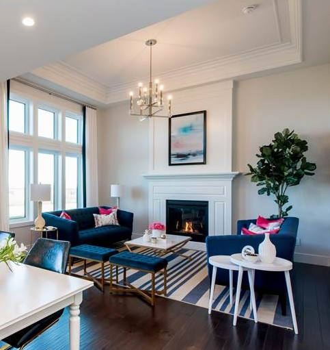 This glam living room by Maison Design and Build is to die for and features trim element from Metrie's Fashion Forward Collection.