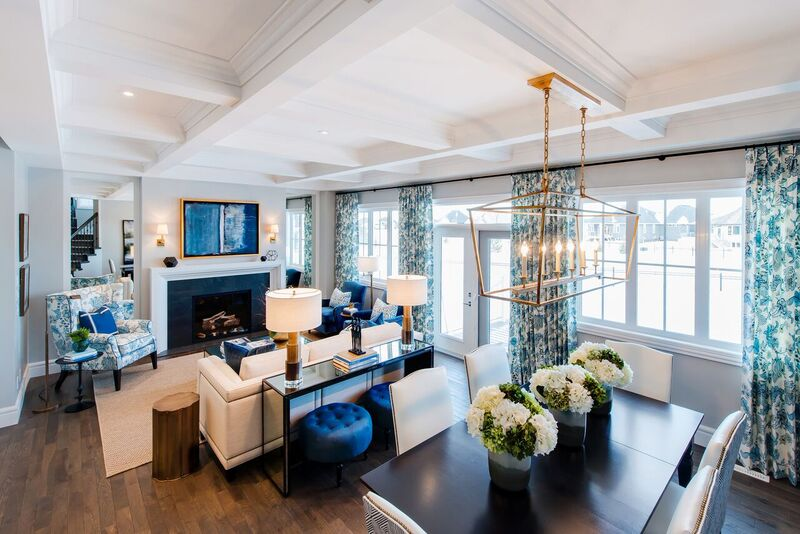 Built and designed by Valentino Homes and Developments with celebrity designers Curtis Elmy and Trevor Ciona of Atmosphere Interior Design, this room features crisp white walls and blue accents. The deep coffered ceiling, created with trim elements from Metrie's Fashion Forward Collection adds grandeur to the space.