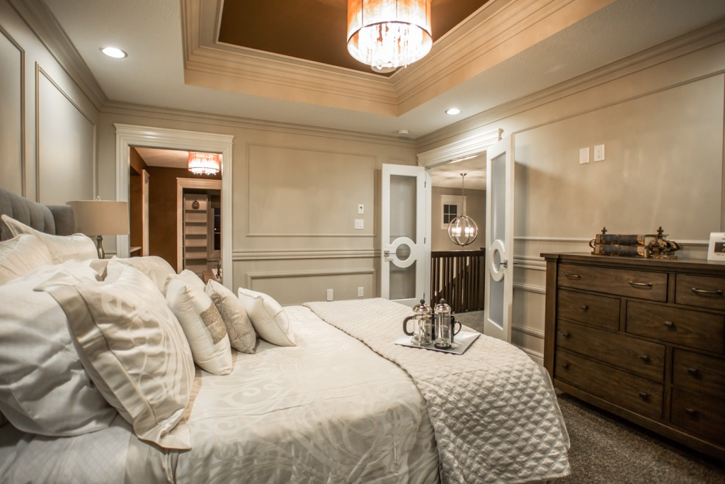 Fashion Forward wainscoting doesn't have to be painted white, Harmony Builders keeps it artfully monochromatic.