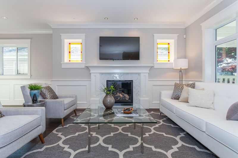 This Very Square wainscoting perfectly frames the mantle in the living room of this Friendly Decorator home.