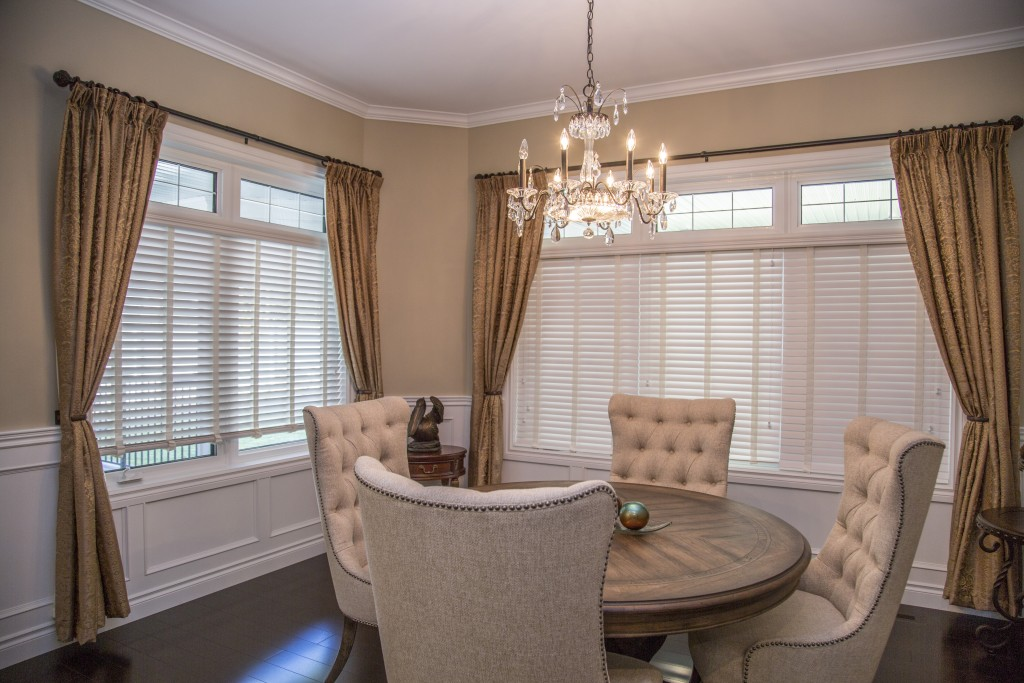 Update your builder's grade dining room with wainscoting. Mint Homes can show you what to do...