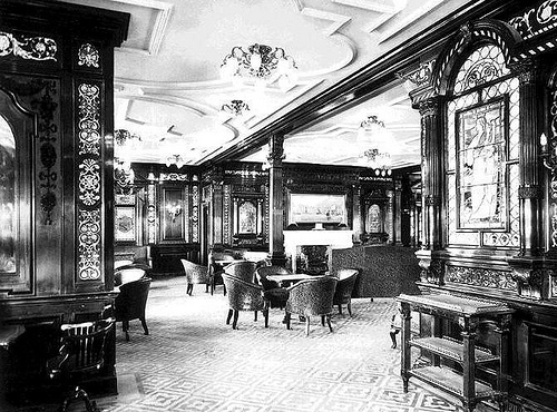 A vintage image showcasing the exquisite interior finishings in the Titanic's first class smoking room.