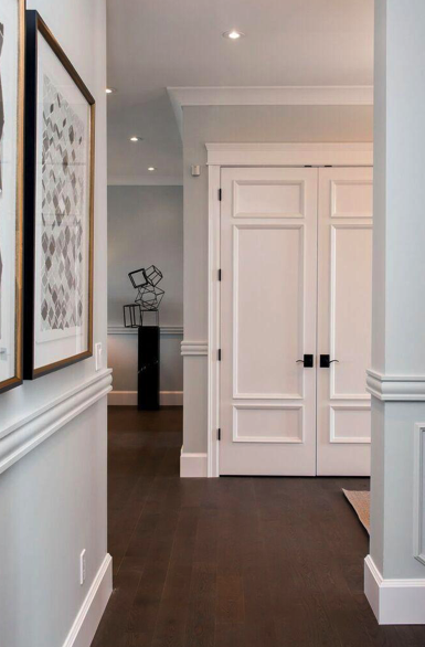 Atmosphere Interior Design using  Metrie Pretty Simple doors in this tranquil entryway.