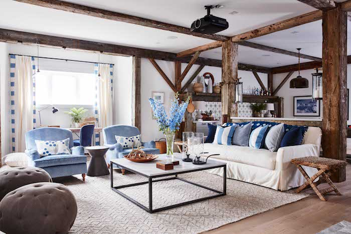 A barn house inspired Media room that is accented with beautiful and large wood timbers.