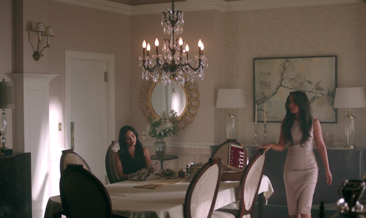 Hermione and Veronica Lodge shares a mother-daughter moment in their trim embellished dining room.