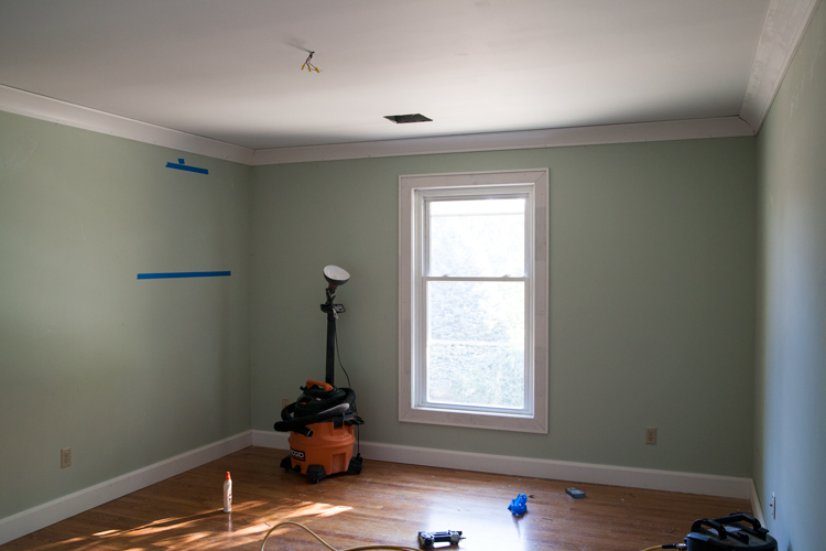 Brittany is ready to hunker down in the master bedroom to install Metrie's Complete Pre-Painted Shiplap.