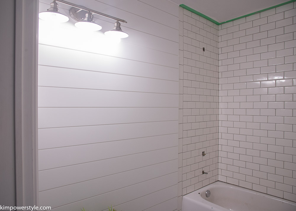 No modern farmhouse bathroom is complete without shiplap, and Kim's design is spot-on.