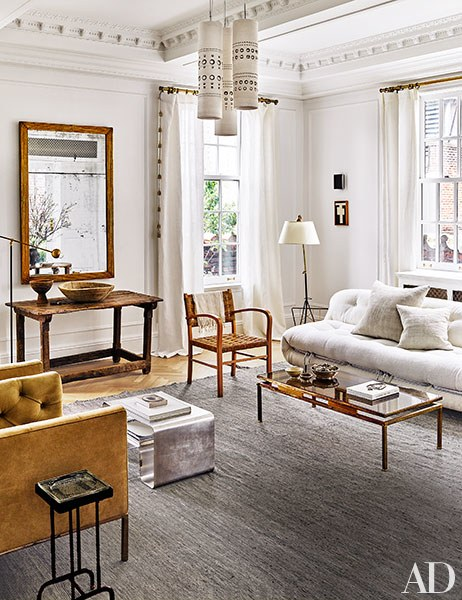 Celebrity designer Dan Berkus and his partner reveals their New York City apartment boasting in ornate trim.