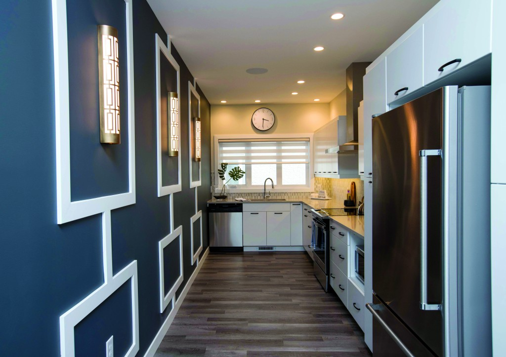 Signature Homes used Metrie's Very Square Collection and flat stock to design this galley-style kitchen.