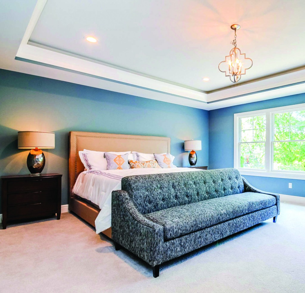 A serene bedroom designed by Forest Hills Homes LLC using Metrie's Fashion Forward Collection,