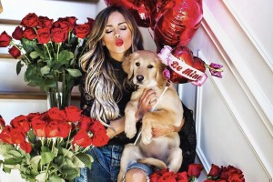 Fashion blogger Maria, of Mia Mia Mine, shares a photograph of herself along with her snuggly puppy.