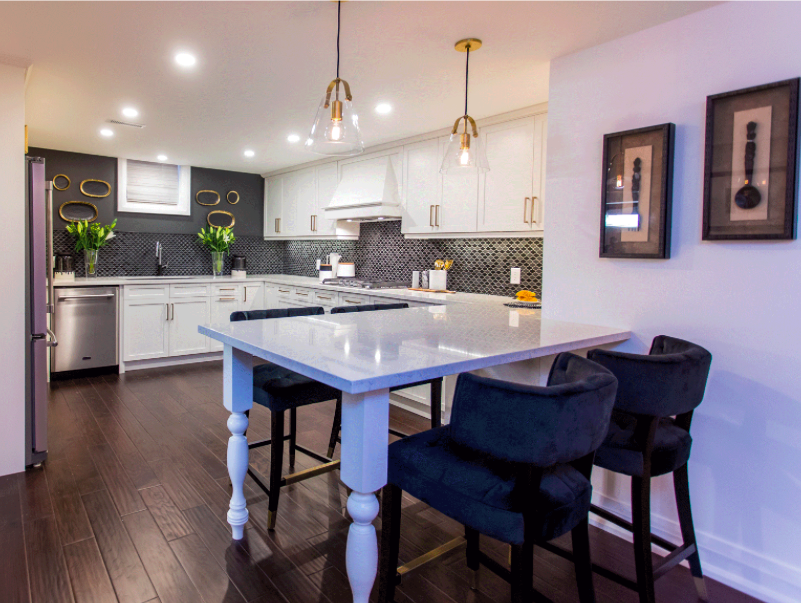 Metrie's baseboard makes an appearance in this open-concept kitchen, on 'Bryan Inc.'