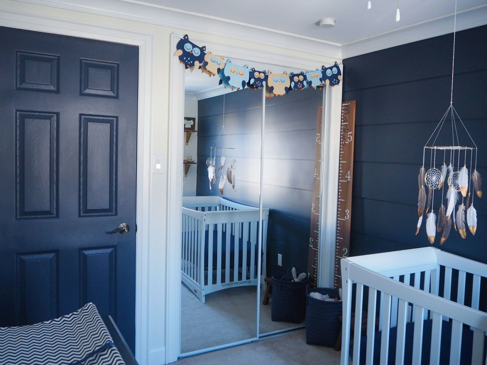 A whimsical owl-themed nursery embracing Metrie's interior finishings.