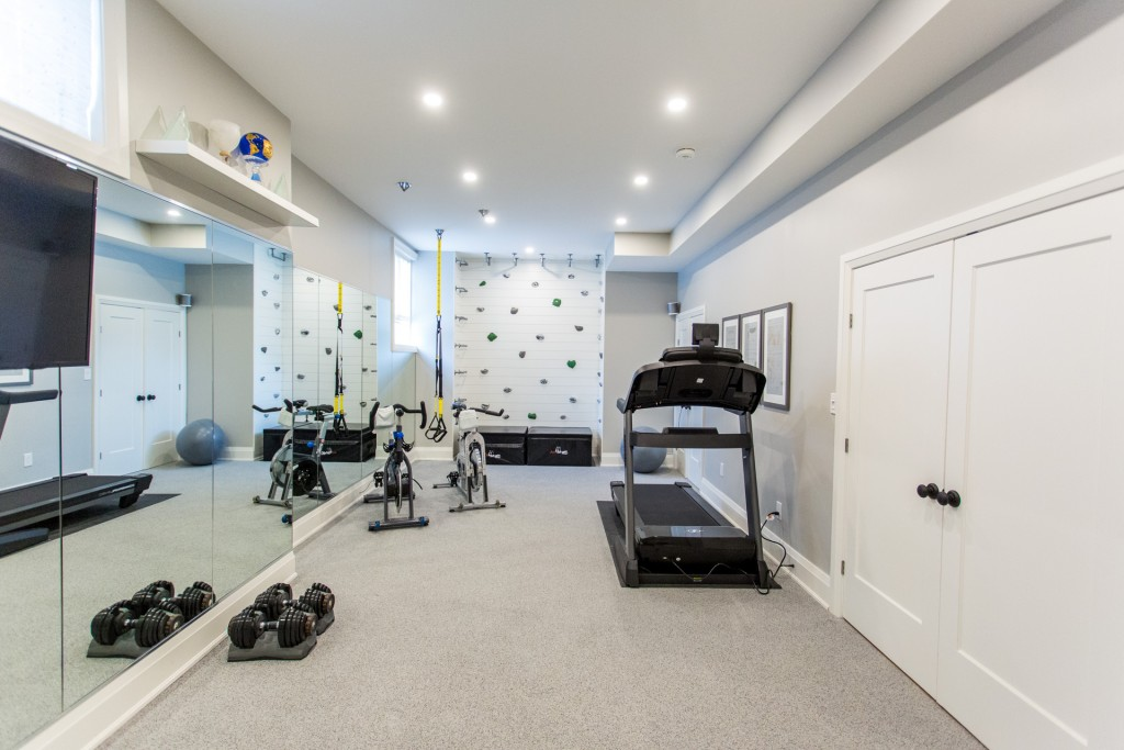 A home gym featuring Metrie's shiplap and doors is featured on Bryan Inc.