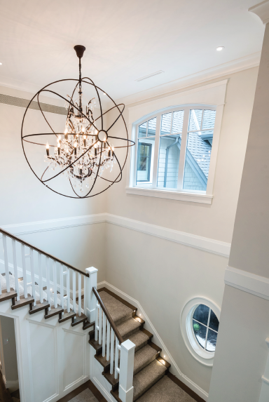 Metrie's Very Square crown moulding makes an appearance in this grand stairway