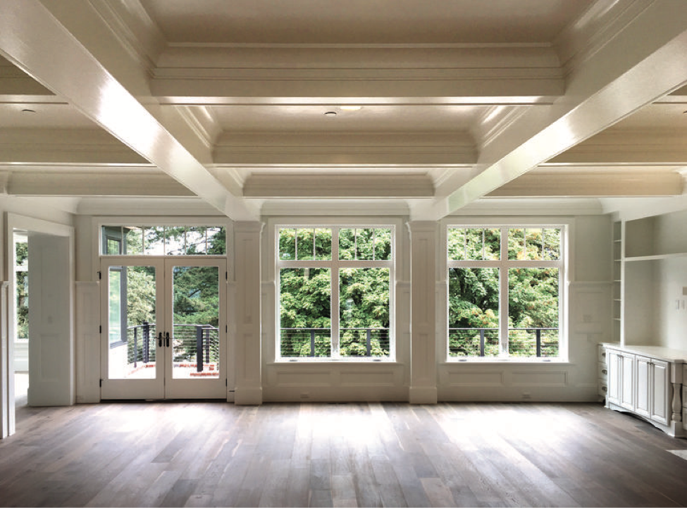Interior finishings enhance the large windows in this space.