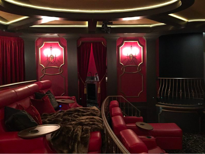 Lose yourself in this majestic home theatre, in Saskatoon, created by Decora Homes Ltd