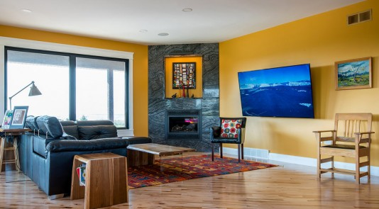 Bold mustard yellow creates a global look in this eccentric space.