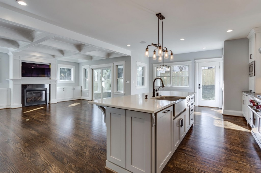 Classic Cottages masterfully designed this kitchen and great room with Metrie's Very Square Collection