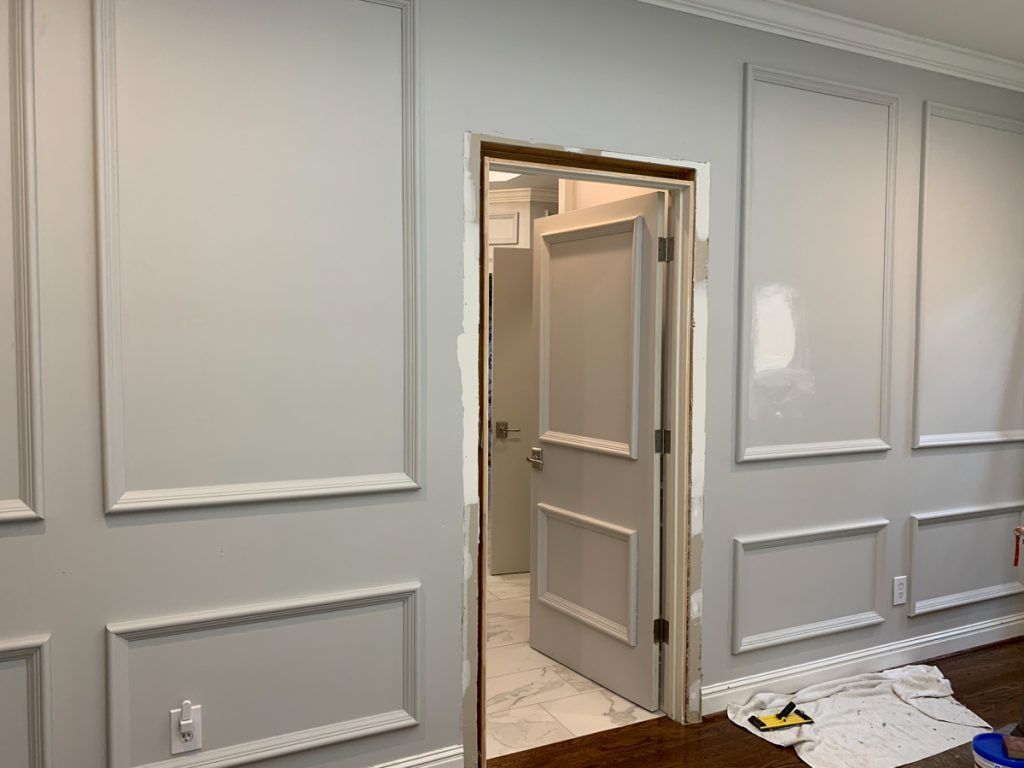 Leslie Davis, of Deeply Southern Home, paints interior finishings from Metrie's French Curves Collection in a beautiful, neutral gray.