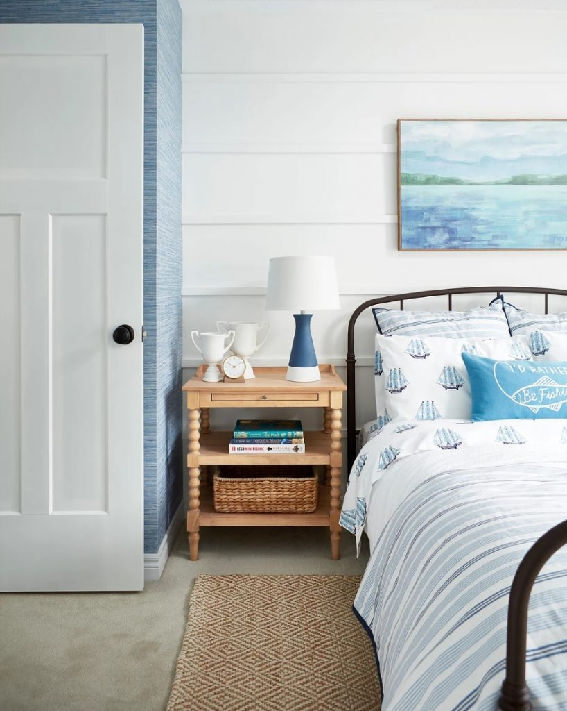 Interior designer Sarah Gunn embraces Masonite's Winslow interior door, by Metrie, in her son's Coastal-inspired bedroom.